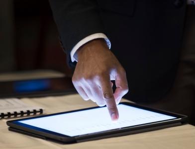 Finger pointing at iPad